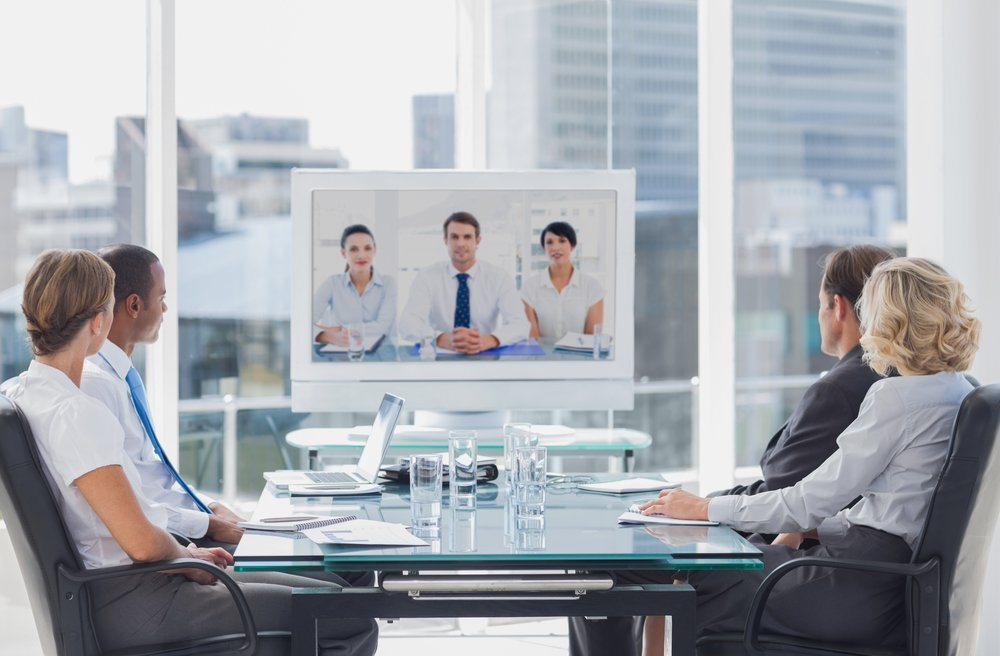 Business team having video conference with another business team in office-1